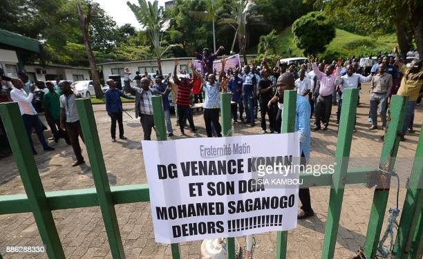 Employees of Ivorian newspaper 'Fraternite Matin' take part in a strike to demand the resignation of CEO Venance Konan and deputy CEO Mohamed...