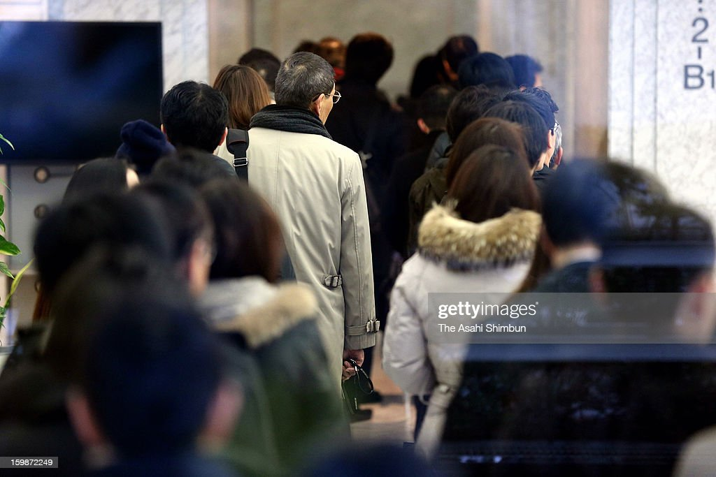 Employees of Japanese plant constructor JGC Co enter their office a day after death of their seven colleagues were confirmed on January 22, 2013 in Yokohama, Kanagawa, Japan. Japanese government officials, president and staffs of Japanese plant constructor JGC Co, who are in In Anemas confirmed seven Japanese nationals were killed in the Algerian hostage crisis.