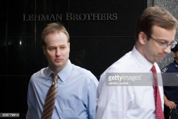 Employees of Lehman Brothers exit the company headquarters in Midtown Manhattan on the day that the company filed for bankruptcy