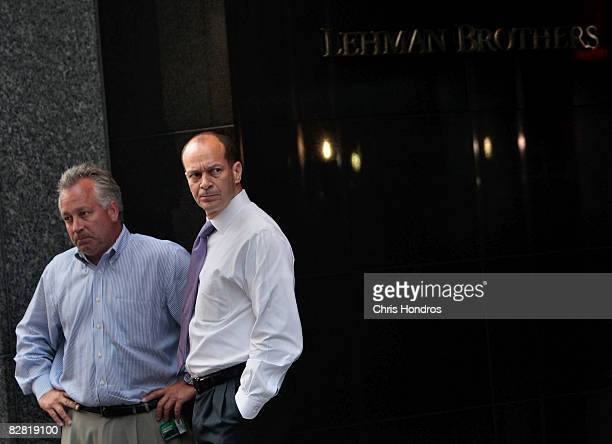 Employees of Lehman Brothers stand outside the company's headquarters building September 15 2008 in New York Lehman Brothers filed a Chapter 11...