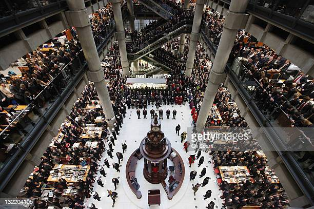 Employees of Lloyd's observe a two minute silence on Armistice Day in the Underwriting Room of Lloyd's Building on November 11 2011 in London England...