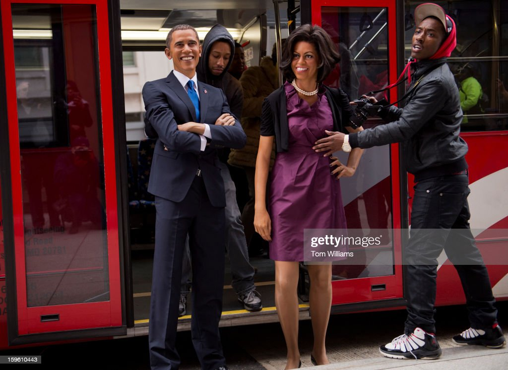 Employees of Madame Tussauds wax museum unload figures of President Barack Obama and First Lady Michelle Obama after the pair arrived from an open top bus ride through downtown.