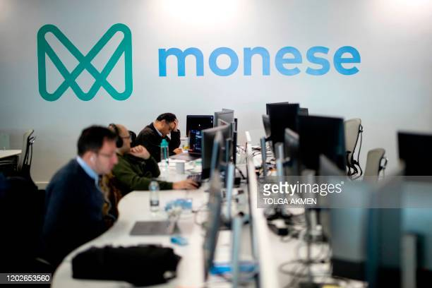Employees of mobile phone appbased 'neobank' Monese work at Monese offices in London on February 7 2020 Among Britain's digital appbased challenger...