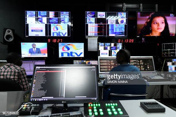 Employees of NTV work at the studio of Kenyan 'Nation Media Group' in Nairobi on January 19 2018 / AFP PHOTO / SIMON MAINA