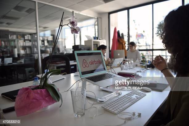 Employees of online lodging service Airbnb work in the Airbnb offices in Paris on April 21 2015 AFP PHOTO / MARTIN BUREAU
