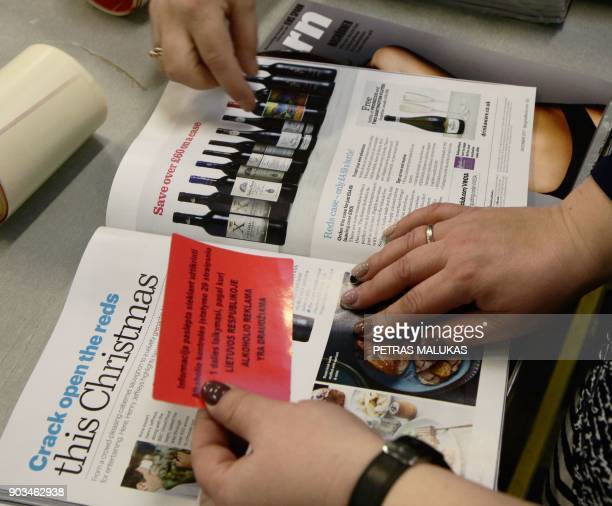 Employees of Press Express the largest distributor of foreign papers plaster over alcohol ads with blanket ban on alcohol ads on pages of a magazine...