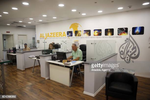 Employees of Qatar based news network and TV channel AlJazeera are seen on their duty at the Jerusalem office where on July 29 2017 Prime Minister...