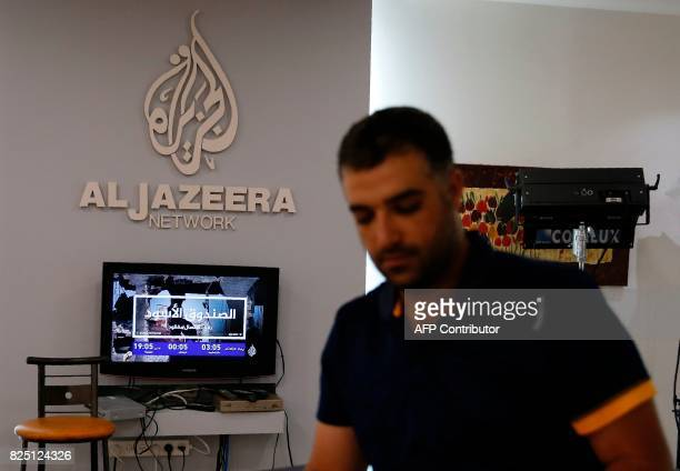 Employees of Qatar based news network and TV channel AlJazeera are seen at their Jerusalem office on July 31 2017 Israel said on August 6 2017 that...