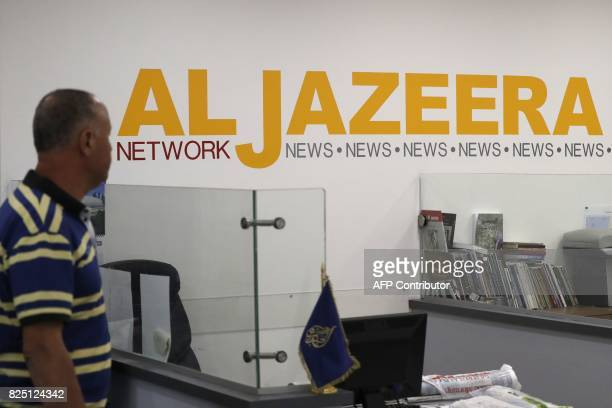 Employees of Qatar based news network and TV channel AlJazeera are seen at their Jerusalem office on July 31 Israel said on August 6 2017 that it...