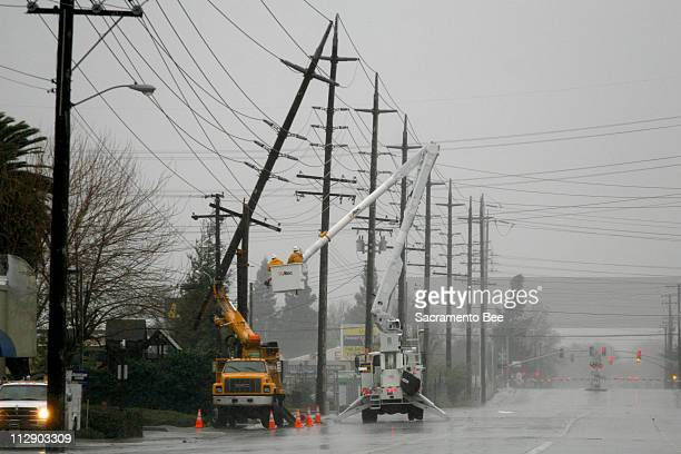 Employees of Sacramento Municipal Utility District work on power lines in Sacramento California Friday January 4 2008 Northern California was under...