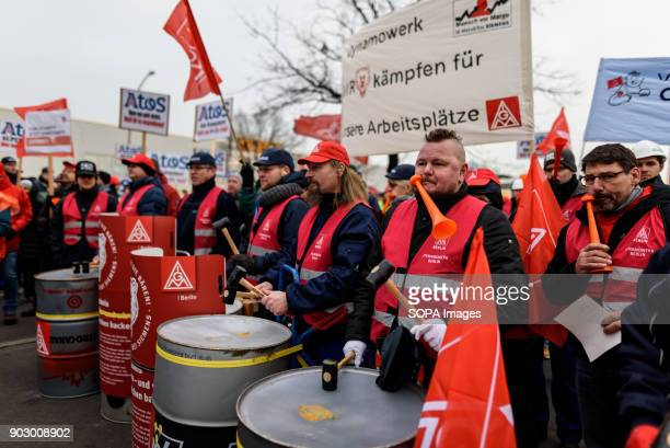 Employees of Siemens seen drumming with hammers during the protest Employees of Siemens company demonstrate against the planned dismissal of workers...