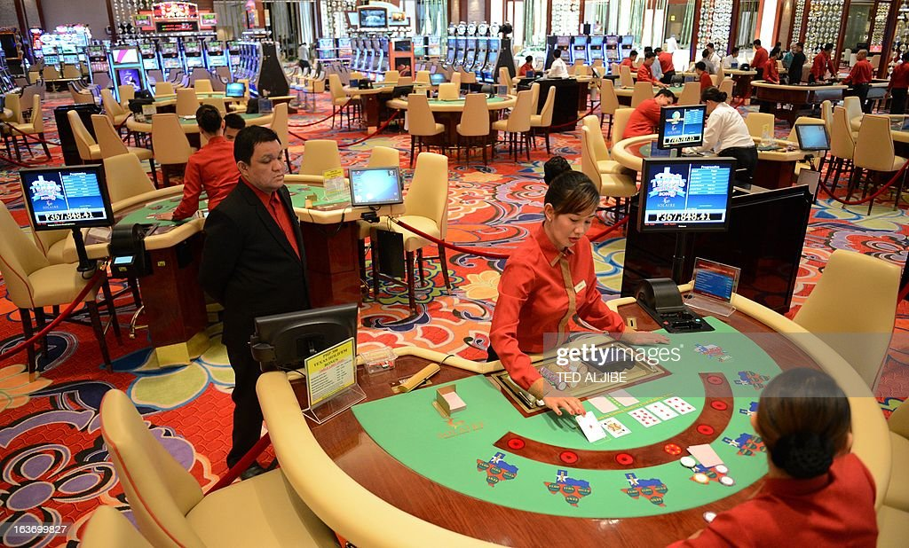Employees of Solaire Manila Resorts and casino simulate a game during media day, inside the casino in Manila on March 14, 2013, ahead of its opening on March 16