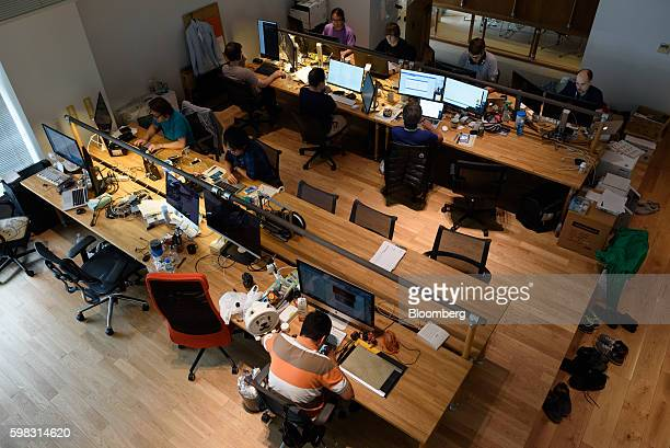 Employees of startup companies that got financial backing from Mistletoe Inc work in front of computer screens at the Mistletoe Base Camp Tokyo...