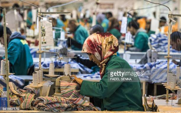 Employees of Still Nua's fashion work at a textiles factory in an industrial park connected to a free-trade zone in the Moroccan city of Tangiers on...