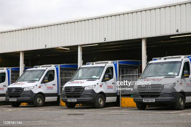 Employees of Tesco Plc leave their grocery delivery trucks parked in loading bays at a Tesco superstore in the Bow district of London, U.K., on...