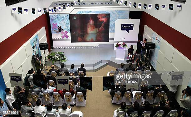 Employees of Thailand's private company Shin Satellite along with other guests gather to watch the live telecast in Bangkok as a European Ariane 5...
