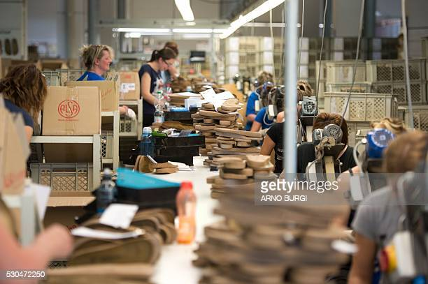 Employees of the Alsa GmbH company in Goerlitz eastern Germany works on the production of Birkenstock shoes on May 10 2016 / AFP / dpa / Arno Burgi /...