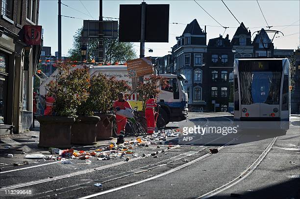 Employees of the Amsterdam cleaning service tidy the streets in central Amsterdam the day after after Queens day on May 1 2011 AFP PHOTO/ANP/ERIK...