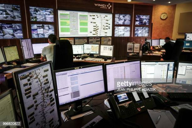 Employees of the Autoroutes du Sud de la France watch video monitors at the security headquarters on July 9 2018 in Valence southeastern France
