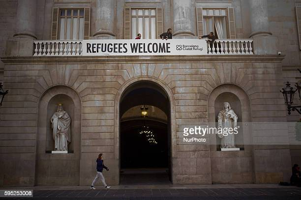 Employees of the City of Barcelona placed a banner reading Refugees Welcome on the main facade of the town hall on 16 March, 2016. After the decision...