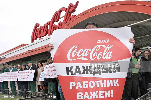 Employees of the CocaCola plant hold posters reading Every worker is important during a rally near the plant in StPetersburg 20 April 2007 The...