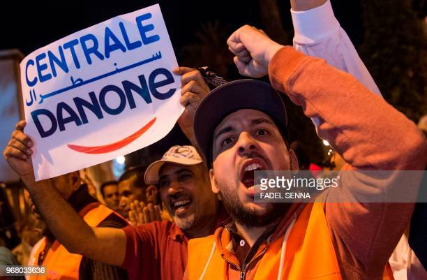 Employees of the company Centrale Danone a subsidiary of French multinational Danone protest in front the parliament in Rabat on June 5 against the...