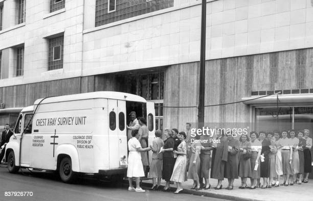 Employees of the Denver Post line up at mobile unit to receive free chest Xrays provided by the Denver Tuberculosis society The Xray unit also is...