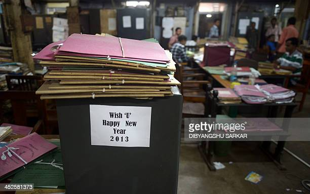 Employees of the eastern Indian state of West Bengal work at the state Secretariat Building or Writer's Building in Kolkata on October 3 as packing...