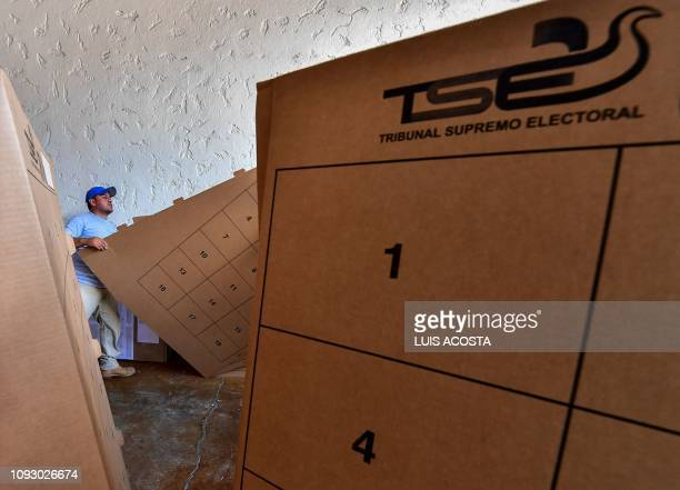 Employees of the Electoral Supreme Court of El Salvador carry electoral material to polling stations in San Salvador, on February 2, 2019 ahead of...