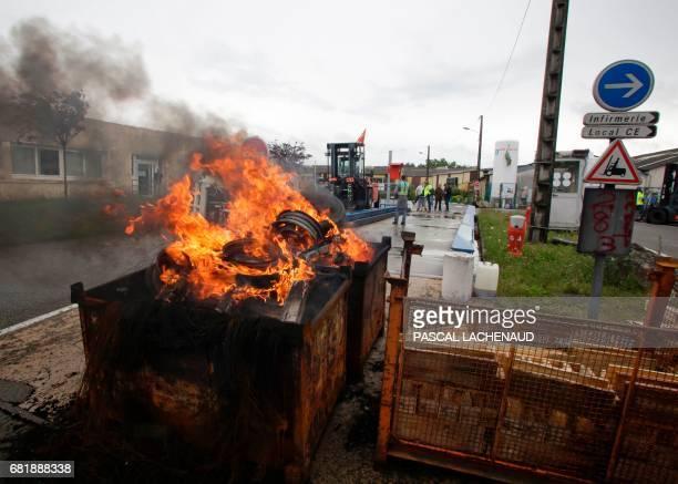Employees of the enterprise GMS La Souterraine start a dumpster fire with production machines on May 11 2017 in La Souterraine Employees of the...
