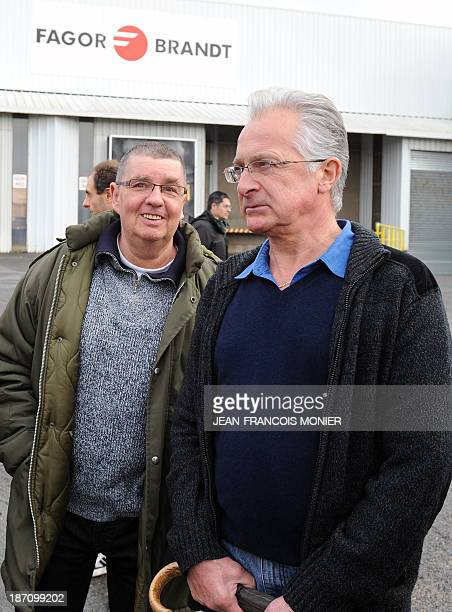 Employees of the FagorBrandt factory gathered outside the factory in Vendome, central France, react as they leave the site after the announcement of...