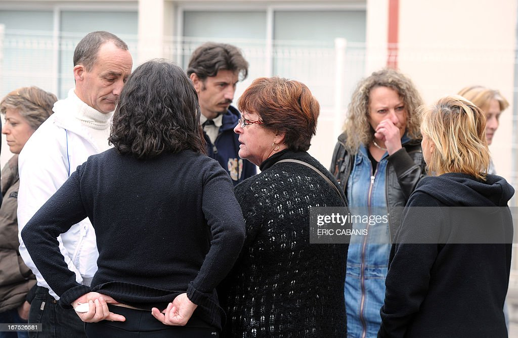 Employees of the French meat food industrial Spanghero are in front of the company's plant in Castelnaudary on April 26, 2013 following a meeting with members of the board and employees' representatives. Spanghero, the French company which sparked an European food alert by allegedly passing off 750 tonnes of horsemeat as beef which led to its sanitary licence being revoked, was placed into receivership on April 19, 2013 according to the Commercial Court in Carcassonne, with a possible continuation of its activity for three months, but only to be renewed once.