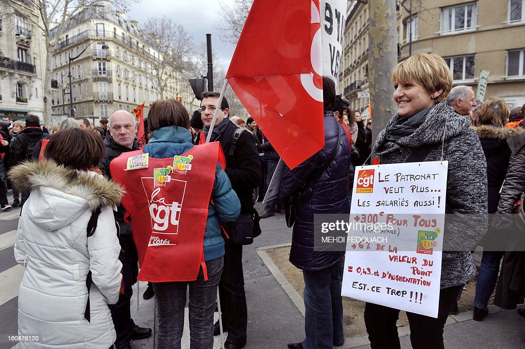 Employees of the French Social Security take part in a demonstration on February 7, 2013 in Paris, during a nationwide strike called by unions for wage increases and against job cuts and restructuring plans.