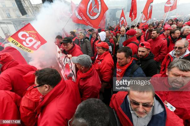 Employees of the French state owned railway company SNCF demonstrate in front of the Gare de lEst railway station in Paris on March 22 2018 to...