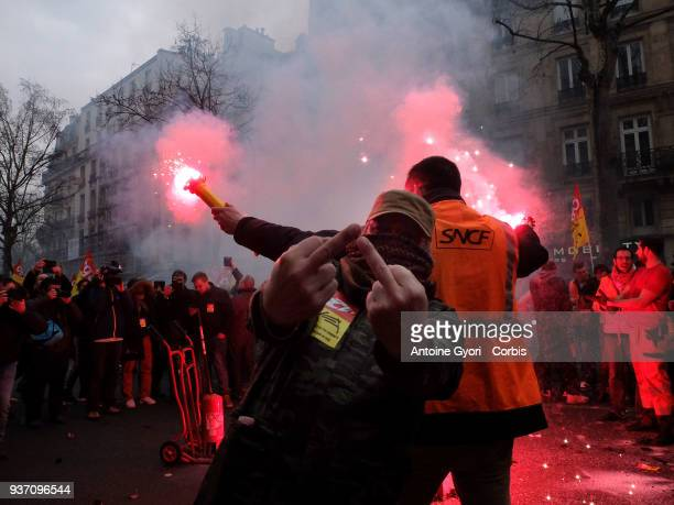 Employees of the French state owned railway company SNCF demonstrate in front of the Gare de l'Est railway station in Paris on March 22 2018 to...
