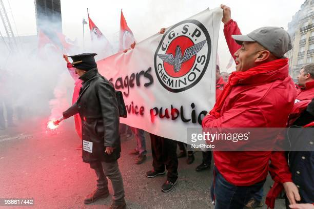 Employees of the French state owned railway company SNCF holding a banner reading « railway workers and users let us resist together for a real...