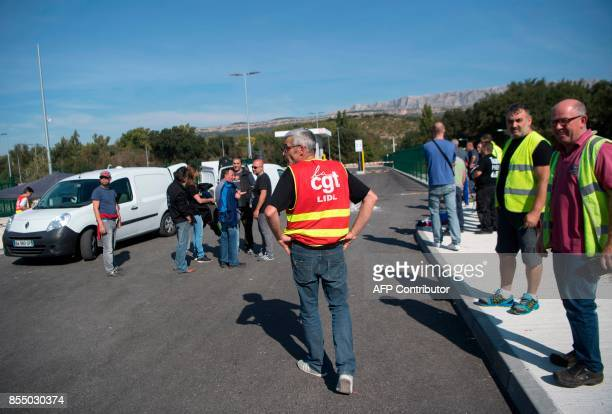Employees of the German discount food retailer Lidl block the acess of a Lidl distribution centre during a strike in Rousset southern France on...