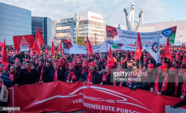 Employees of the German luxury car maker Porsche demonstrate during of a warning strike on January 15 2018 in Stuttgart southwestern Germany Strikes...