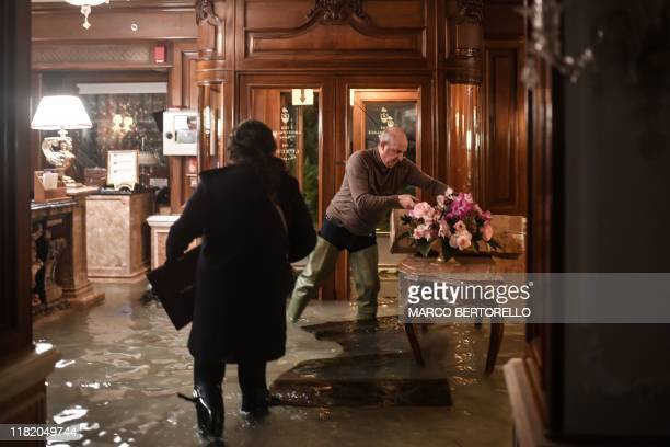 TOPSHOT Employees of the Gritti Palace protect furniture during an exceptional Alta Acqua high tide water level on November 12 2019 in Venice...