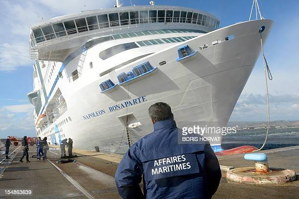 Employees of the harbour and of the French SNCM company which manages Mediterranean sea transport shuttles look at the ferry NapoleonBonaparte which...