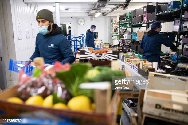 Employees of the highend fresh food wholesaler Natoora pick orders for home deliveries after the company decided to open up their customer list to...