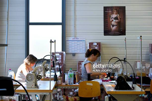"""Employees of the """"Indiscrete"""" lingerie brand work on July 1, 2013 at the company's production site in Chauvigny, centralwestern France. The brand..."""