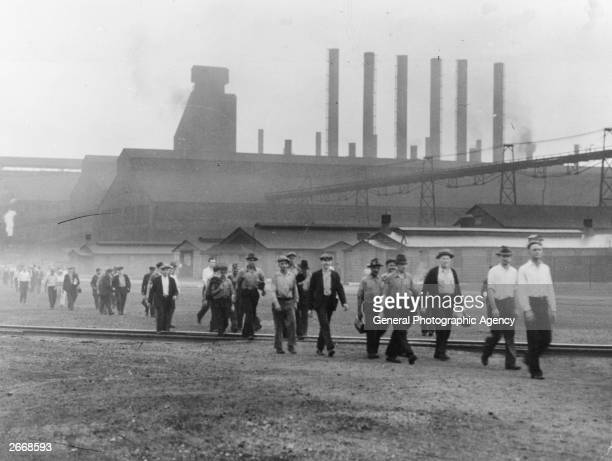 Employees of the Inland Steel Company Indian Harbor an industrial suburb of Chicago leaving one of the mills after a day's work