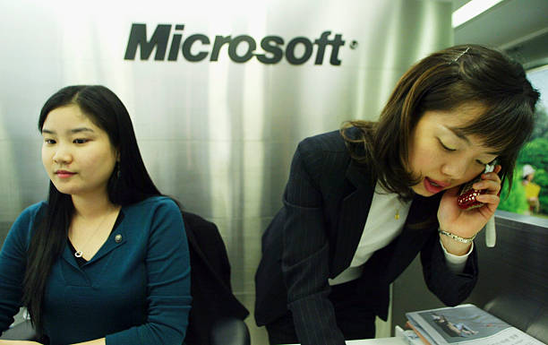 Employees of the Microsoft Corporation work at their head office on December 7 2005 in Seoul South Korea South Korean Antitrust Regulators today...