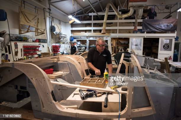 Employees of The Morgan Motor Company work in the wood shop of the car firm's factory in Malvern southwest of Birmingham central England on August 13...