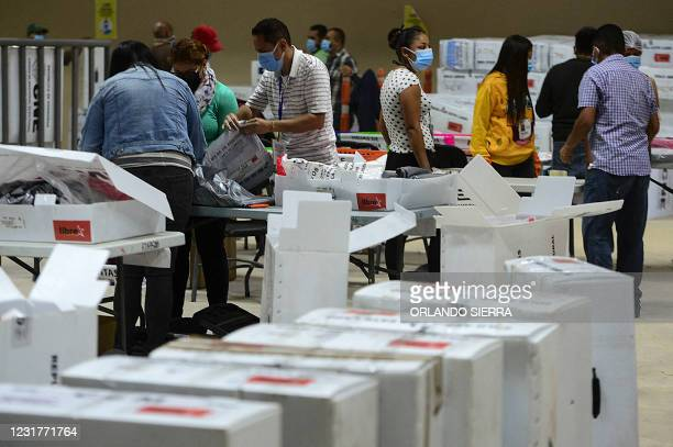 Employees of the National Electoral Council select electoral ballots to start the proceedings scrutiny in Tegucigalpa, on March 17, 2021. - The...