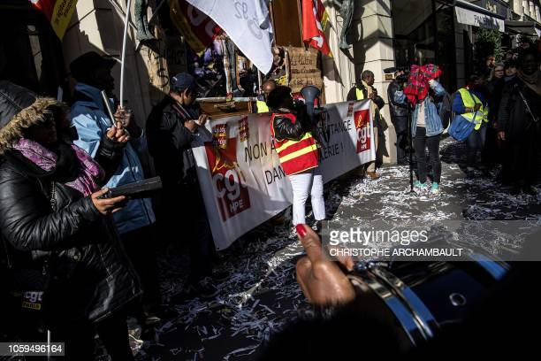 Employees of the Park Hyatt Vendome and supporters shout slogans and play music as they stage a protest to support striking cleaning staff outside...