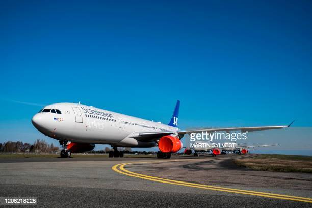 Employees of the SAS airline agreed to have their pay cut down during the COVID-19 crisis. / Denmark OUT
