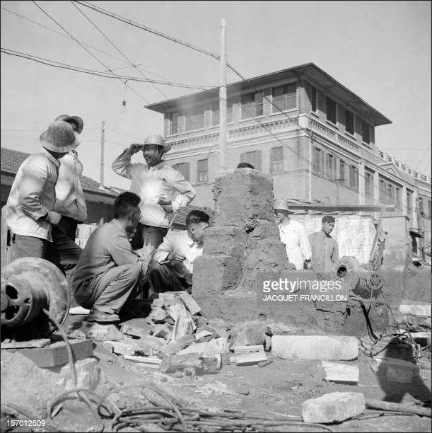 Employees of the Shin Chiao Hotel in Beijing build in the hotel courtyard in October 1958 a small and rudimentary smelting steel furnace during the...