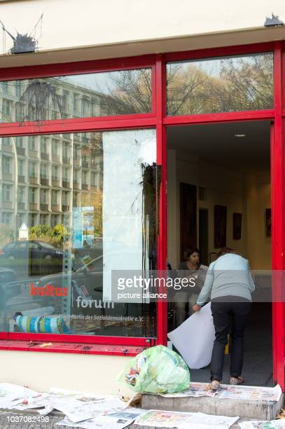 Employees of the Social Democratic Party  in Berlin clean up after a paint bomb and stone throw attack against the SPD headquarters in Berlin Germany...